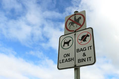 Council signs regarding dogs and horses Stock Images