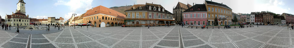 The Council Square, Brasov, 360 degrees panorama. A 360 degrees panorama made at the Council Square, Brasov. The Old Town, including the Black Church and main royalty free stock images