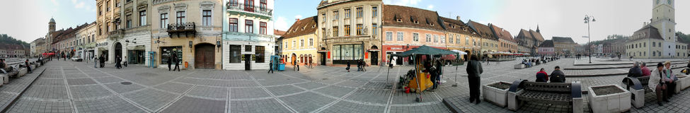 The Council Square, Brasov, 360 degrees panorama. A 360 degrees panorama made at the Council Square, Brasov. The Old Town, including the Black Church and main stock photo
