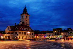 The Council Square in Brasov, Romania. The Council Square with the City hall, in the old center of Brasov, Romania. HDR picture taken at the blue hour Royalty Free Stock Images