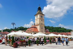 Landmark attraction in Brasov, Romania: Tourists in the Council Square and the Council House Stock Photography