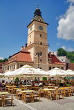 Landmark attraction in Brasov, Romania: Tourists in the Council Square and the Council House Stock Image