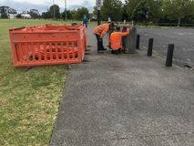 Council workers checking meter at park stock image