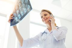 Cheerful medical worker discussing x ray scan picture of patient stock photography