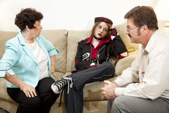 Counseling - Exasperation. Mother and teen daughter in family therapy together Royalty Free Stock Photo