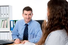 Counseling interview. Business men and women in counseling interview stock image
