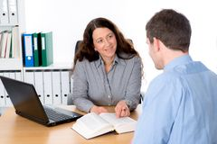 Counseling interview. Business women and men in counseling interview stock image