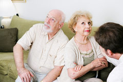 Counseling - Poor Communication. Senior couple seeing a marriage counselor, won't speak to one another Royalty Free Stock Photography