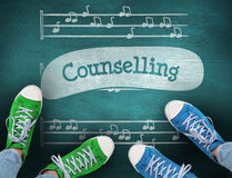 Counselling against green chalkboard. The word counselling and casual shoes against green chalkboard Stock Image