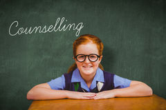 Counselling against green chalkboard. The word counselling and smiling pupil against green chalkboard Stock Images