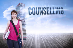 Counselling against stack of books against sky. The word counselling and woman holding her school notebooks against stack of books against sky Royalty Free Stock Photos