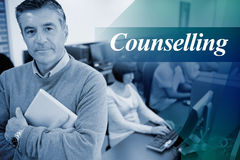 Counselling against teacher standing while holding a tablet pc. The word counselling against teacher standing while holding a tablet pc stock image