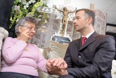 Counselling in the chapel. Man royalty free stock photography