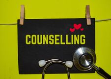 COUNSELLING on top of yellow background. A stethoscope and blackboard with word COUNSELLING on top of yellow background. Medical, health and education concepts royalty free stock photography