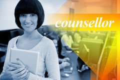 Counsellor against teacher with tablet pc Stock Photo
