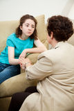 Counselor Comforts Teen Stock Images
