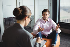 Counselor consoling unhappy man. Counselor consoling unhappy men during therapy Royalty Free Stock Image