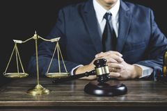 Counselor or Male lawyer working on courtroom sitting at the table. Legal law, Judge gavel with Justice lawyers advice with gavel. And Scales of justice stock photos