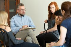 Counselor talking to his patients during group therapy for rebel royalty free stock photos