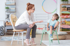 Counselor talking with worried boy stock photos
