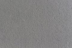 Counstructed湿灰色粗砺的膏药墙壁 库存图片