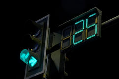 Count down watch and green light time. Traffic sign in the night royalty free stock images