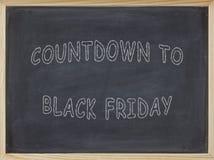 Count-down zu Black Friday-Fleisch geschrieben auf eine Tafel Lizenzfreie Stockbilder