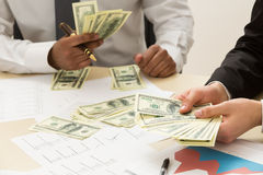 Count earned money. Two clark count earned money Royalty Free Stock Photography