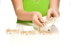 Count the euro. Young women counting the euro Royalty Free Stock Photo