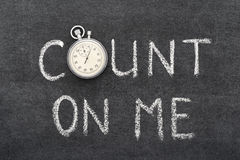 Count on me. Phrase handwritten on chalkboard with vintage precise stopwatch used instead of O stock photo