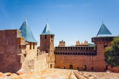 Count`s Castle defensive wall, Carcassonne, France. Count`s Castle defensive wall with towers and hoarding, Carcassonne, France royalty free stock photos