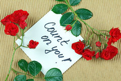 Count on You. Note Count on you, written on white paper and framed with roses stock photography
