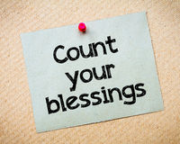Count your blessings. Message. Recycled paper note pinned on cork board. Concept Image stock photo