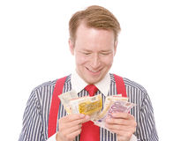 Count your money. Young happy businessman counting his money - isolated on white Stock Photo