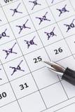Countdown with Calendar. Fountain pen marking days on calendar royalty free stock photography