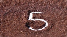 Countdown on chocolate powder stock footage