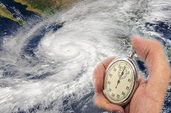 Countdown. Hurricane Patricia and Hand Holding old Stopwatch. Concept of Climate change. Elements of this image furnished by NASA Royalty Free Stock Photography