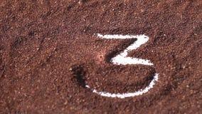 Countdown 5 to 1 on chocolate powder stock footage
