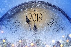 Countdown to midnight. Retro style clock counting last moments before Christmass or New Year 2019 stock images