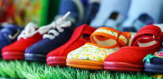 Counter with baby shoes at shop. Counter with baby shoes at fashionable shop. Colorful Royalty Free Stock Photo