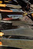 Counter blacksmith kitchen hatchet cutting of meat bones cutting meat large wide blade a lot of guns on a black contrasting. Background stock images