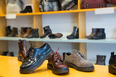 Counter with classic male shoes. At fashionable shop Stock Photos