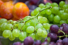 Counter with colorful grapes on market Stock Photo