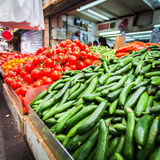 Counter with cucumbers and tomatoes in the market. Stock Photos