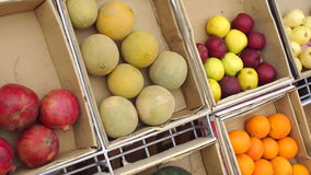 Counter with fruit in wooden boxes, close-up. stock video