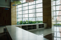 Counter in hall with large glass wall Stock Photos