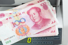 Counter with hundred yuans. Electronic currency counter with hundred yuan Royalty Free Stock Photography