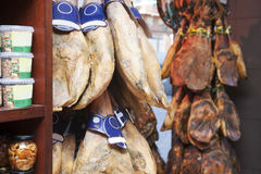 Counter jamon. Display counter  with jamon, beans and boletus Royalty Free Stock Images