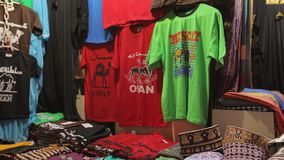 On the counter are local hats, as well as tourist T-shirts with the words Oman