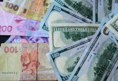 Counter notes, Ukrainian hryvnia, along with dollars. Along with dollars Royalty Free Stock Images